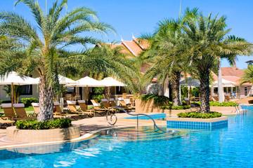 Swimming pool in luxury resort under blue sky