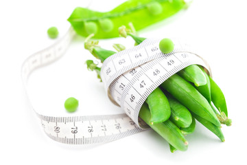 peas and measure tape isolated on white