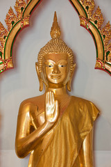 Golden Buddha statue on old background