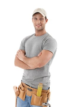 Handsome handyman in baseball hat