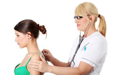 Mature female doctor examining