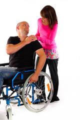 Paar Rollstuhl Fürsorge Hand auf Schulter