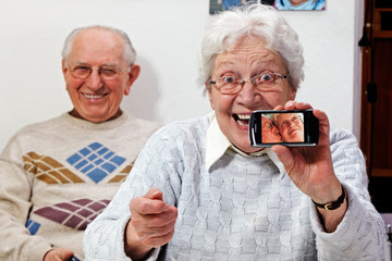 senior couple with smartphone