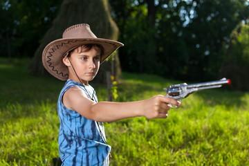 Cute kid playing cowboy
