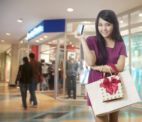 Girl going shopping with credit card