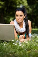 Beautiful woman browsing internet in citypark