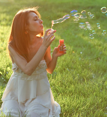 attractive young girl with soap-bubbles