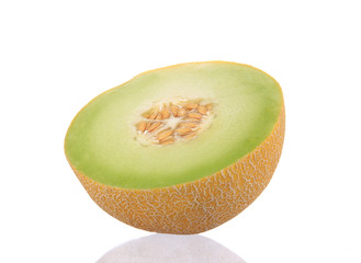 Close-up of melon over white background