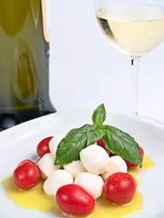 cherry mozzarella caprese, with tomatoes, oil, basil and wine