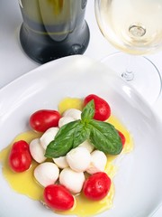 cherry mozzarella caprese, with tomatoes, oil, basil and wine