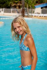 girl in bikini by swim pool