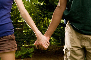 teen romance - interracial couple holding hands
