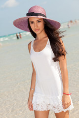Beautiful Young Woman on the Shoreline of South Beach