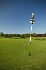 Flag on idyllic golf course
