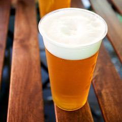 glass of beer standing on a wooden table