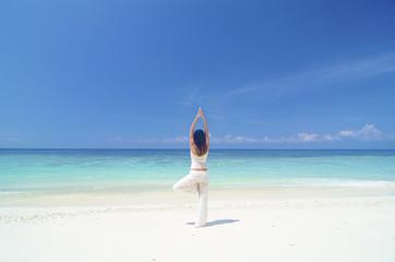 Obraz beach yoga - fototapety do salonu