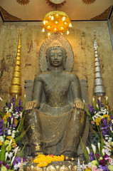 statue of old buddha at thailand temple