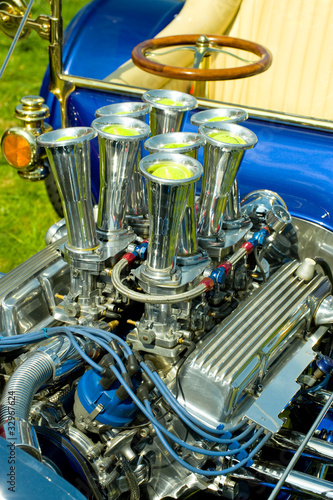 Wall mural chromed hot-rod vehicle engine with tennis balls in the inlets