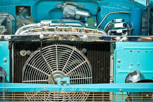 Wall mural engine bay and radiator grille of an classic old american car
