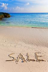 """On a beach it is written """"SALE"""""""