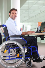 Disabled office worker using a laptop
