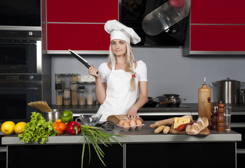 Girl chef in the kitchen