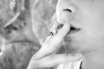 Young Man Smoking a Cigarette