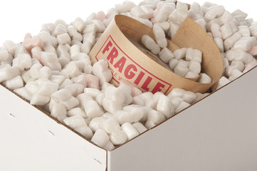 box of packing peanuts with roll of fragile tape inside