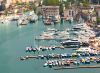 Bay with sailboats in the summer. Tilt Shift effect