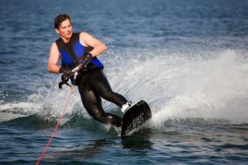 sliding wakeboarder  in water splash Wall mural