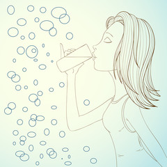 Beautiful girl drinking water on abstract bubbles background