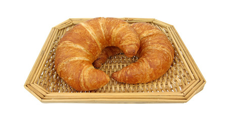 Two croissants in wicker basket