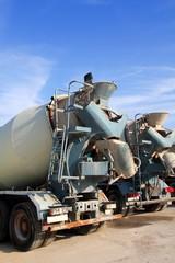 concrete mixer two trucks rear view grunge