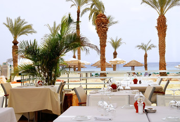 Cafe on the beach among the palm trees