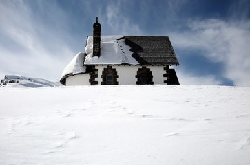 Isolated cottage in snow covered landscape