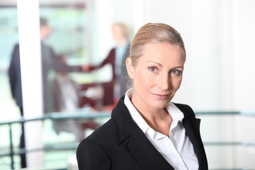 No-nonsense businesswoman in an office environment