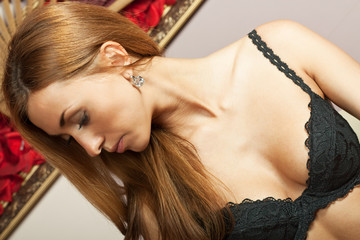 Beautiful young girl in black lingerie