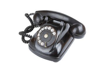 A vintage black telephone isolate on white wallpaper.