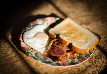 Breakfast with egg, toast and meat