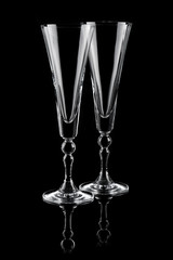 Two empty champagne glasses isolated on black