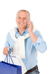 Senior happy man holding shopping bags