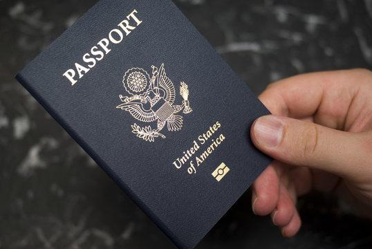 Hand holding American passport