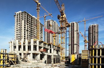 Inside place for  tall buildings under construction and cranes Wall mural