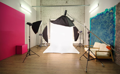 Multiple backgrounds inside studio - light room with lamps