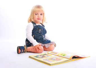 Baby girl with a book