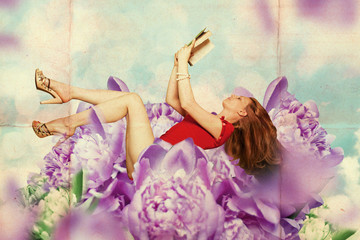 beautiful woman with book in flowers