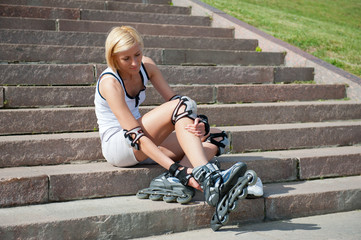 Young woman wears roller skates