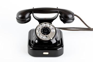 Old vintage telephone on white background