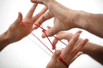 Hand und roter Faden