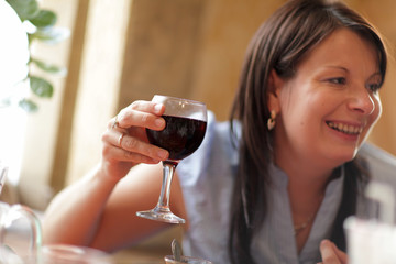 Happy woman with red wine